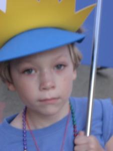It's serious work, umbrella turning, hat wearing, necklace bearing
